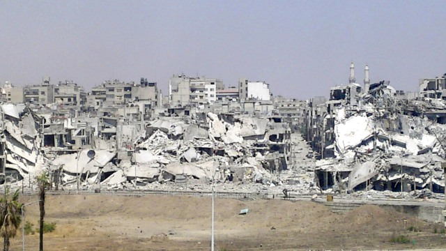 Damaged buildings are seen in Juret al-Shayah